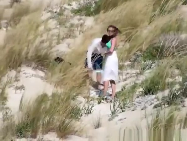 Couple caught fucking in the beach dunes