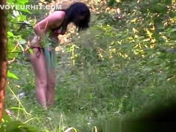 Dark hair woman in bikini take a pee