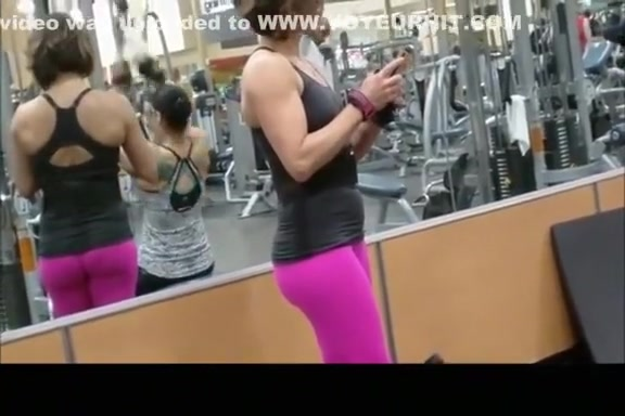 Fit woman wearing tight pink sports pants