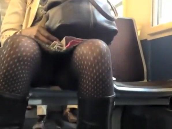 Ebony woman legs upskirt in the train