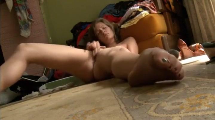 Cute girl rubbing clit on her room floor