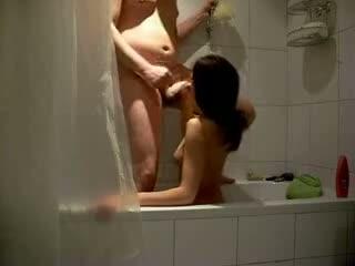 Spy cam captures hot oral sex in the shower
